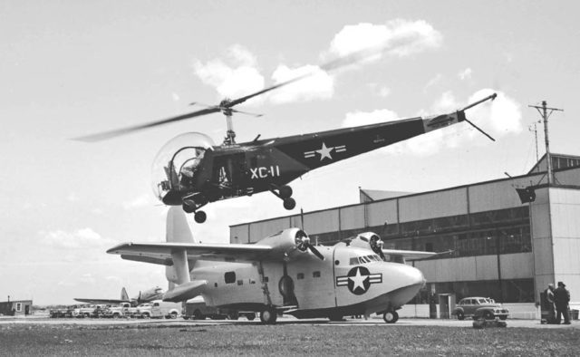 A Bell HTL-1 taking off over a Grumman Albatross prototype at Floyd Bennett Field, May 1948.