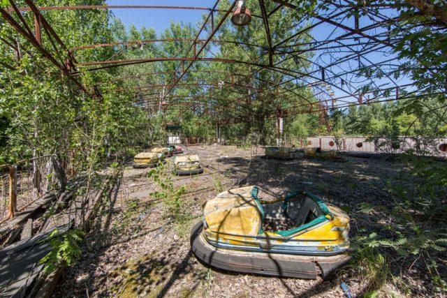 Abandoned amusement park brimming with lush flora. Author: Jonk Photography