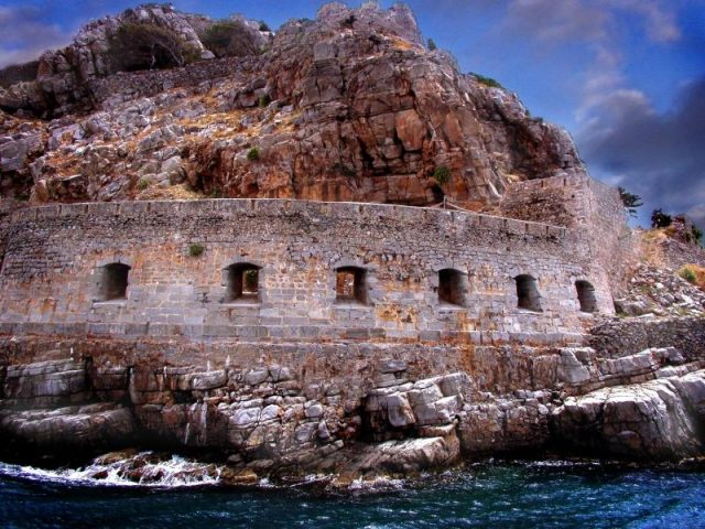 Rocks and wall working together to secure the island. Author:Max Detheridge-SmithCC BY-ND 2.0