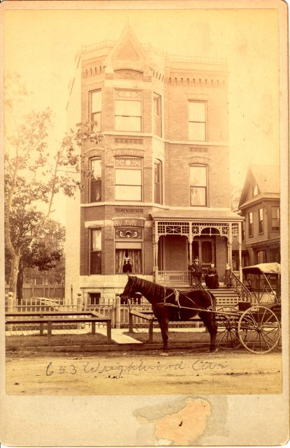 This is an 1880s photo of 653 W. Wrightwood (now 655 W. Wrightwood) in the Lincoln Park neighborhood. The building is typical of the Victorian era structures in the area. Note the wooden sidewalk and dirt road.