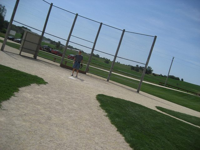 a visitor standing on the home plate. Author:mrsdkrebsCC BY 2.0