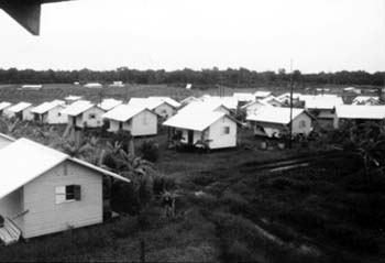 """Houses in Jonestown. Author:Photo Courtesy of""""The Jonestown report"""".CC BY-SA 3.0"""