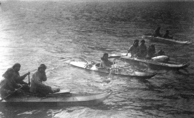 King Island residents in kayaks, about 1892.