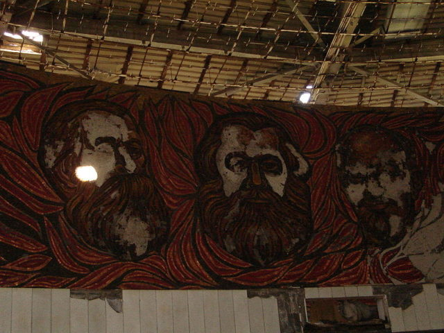 Murals of Friedrich Engels, Karl Marx, and Vladimir Lenin.