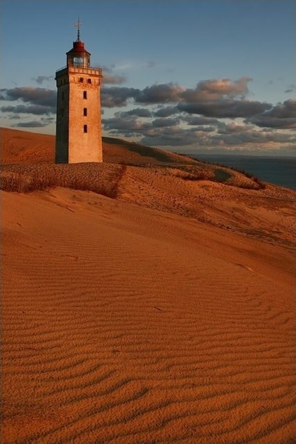 Lighthouse being encroached on by surrounding sand dunes, Rubjerg Knude, Denmark.Eric Dufour– CC-BY SA 3.0