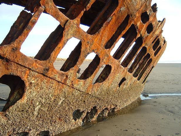 Rust eating what is left of Peter Iredale. Author: KatieCC BY-SA 2.0