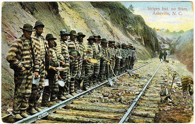 Striped prisoner uniforms.