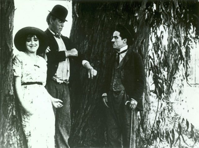 Mabel Normand, Mack Sennett, and Charles Chaplin in The Fatal Mallet (1914).