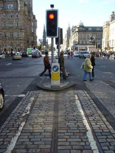 Cable car tracks on Waterloo Place. Author: kim traynor CC BY-SA 2.0