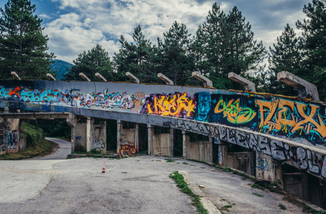 Sarajevo, Bosnia and Herzegovina – August 24, 2015. Abandoned Olympic Bobsleigh and Luge Track, built for the XIV Olympic Winter Games in 1984 and destroyed during Siege of Sarajevo
