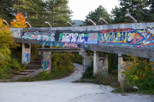 Sarajevo, Bosnia and Herzegovina – October 14, 2013: The abandoned bobsled and luge track from the 1984 Winter Olympics in Sarajevo, Bosnia and Herzegovina. During the siege of Sarajevo (1992-1995), the track was used as an artillery position by Bosnian Serb forces.