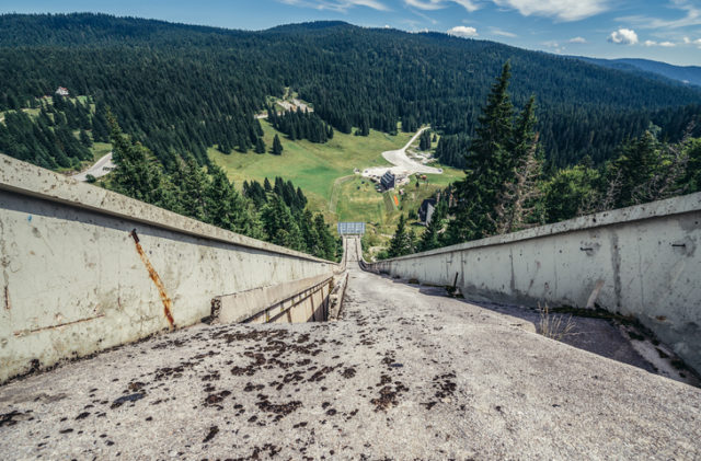 Ilidza, Bosnia and Herzegovina – August 24, 2015. Abandoned Olympic Jumps on the mountain of Igman in Ilidza. The Objects was built for Winter Olympic Games in 1984