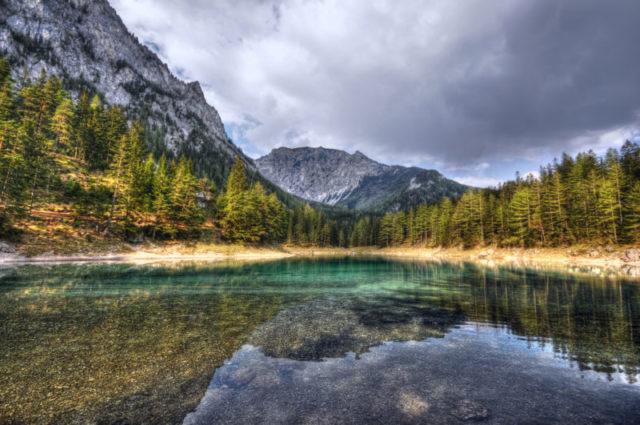 Green Lake in Styria Austria.European Alps. dark clouds reflection in the mountain lake.