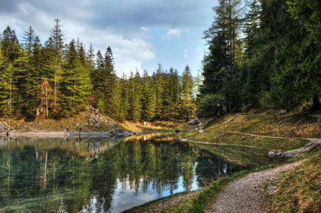 Gruener See, European Alps.Dark clouds reflection in the mountain lake.