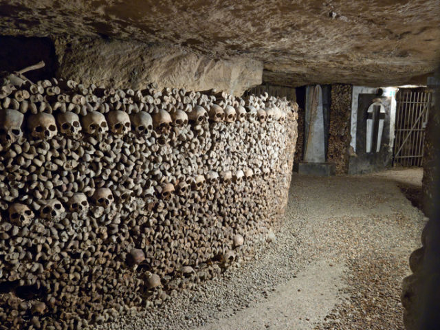 """""""In 1785, Paris decided to solve the problem of its overflowing cemeteries by exhuming the bones of the buried and relocating them to the tunnels of several disused quarries, which were consecrated as a cemetery. It is estimated that about one million bodies are buried here. Paris, France."""""""
