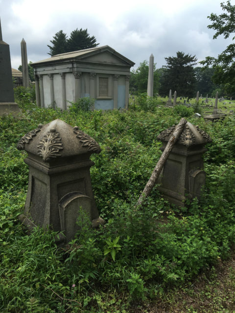 Overgrown and abandoned tombstones, sepulcher with obelisks in the back Author:Shannon McGeeCC BY-SA 2.0
