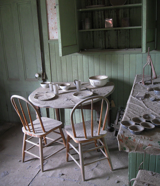 A dining table set for two – Bodie, California – By Nick – CC BY 2.0