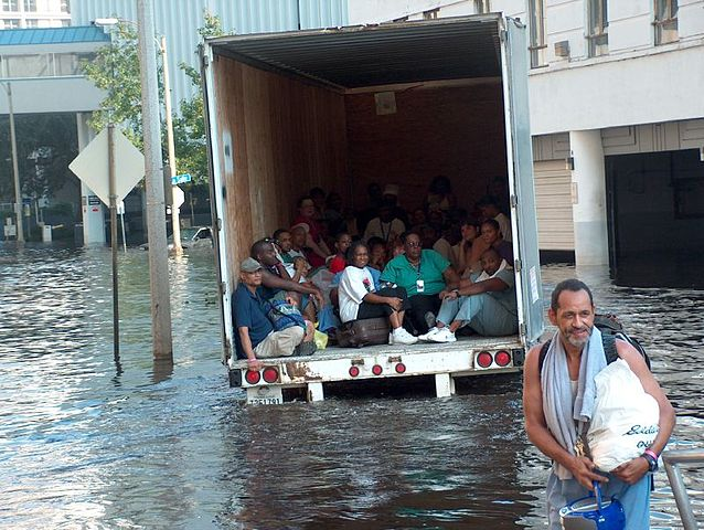 Evacuating by truck through flood waters. Author:Ben RecordCC BY-SA 2.0