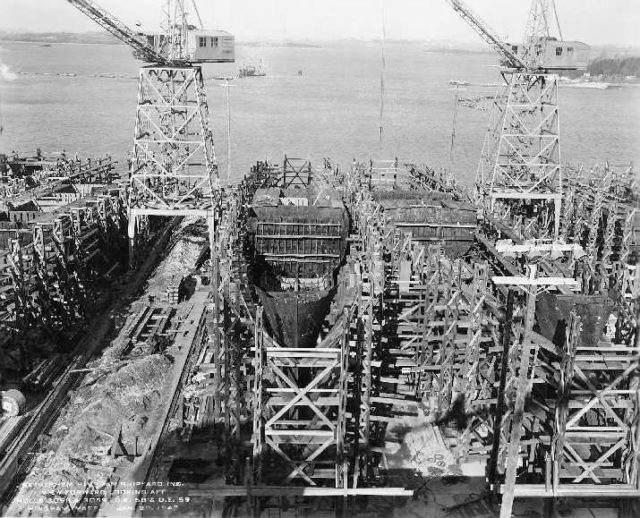 Construction of two warships: HMS Calder as USS Formoe (DE-58) and USS Foss on the right.