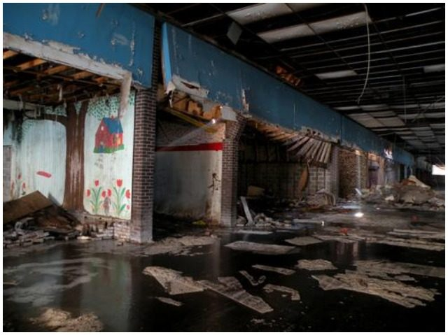 "Image of ""Block B"" of Dixie Square Mall – The interior is completely wrecked, left to rot. Author: Jonrev CC BY-SA 3.0"