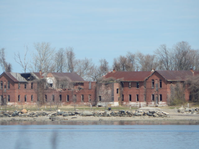 Red Brick Buildings on Hart Island. Author: Adam Moss CC BY-SA 2.0
