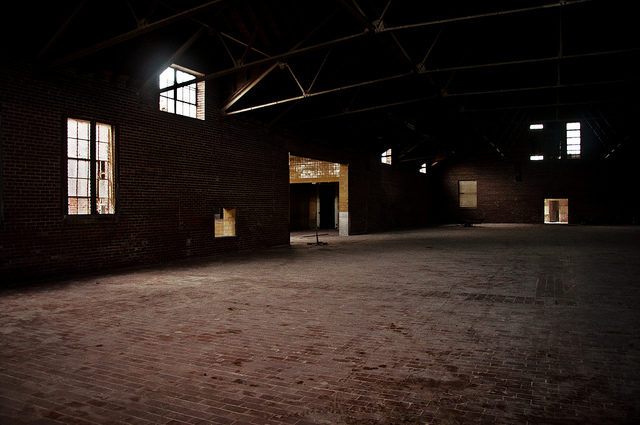 Large room, maybe one of the manufacturing structures. Author: Stuart McAlpine CC BY 2.0
