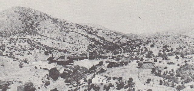 Washington Camp, facing west in 1909. The large mine buildings are the Duquesne Reduction Plant