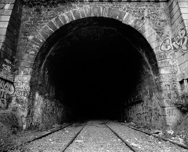 Into the dark tunnels of the Little Belt Railway. Author: Thomas Claveirole CC BY-SA 2.0