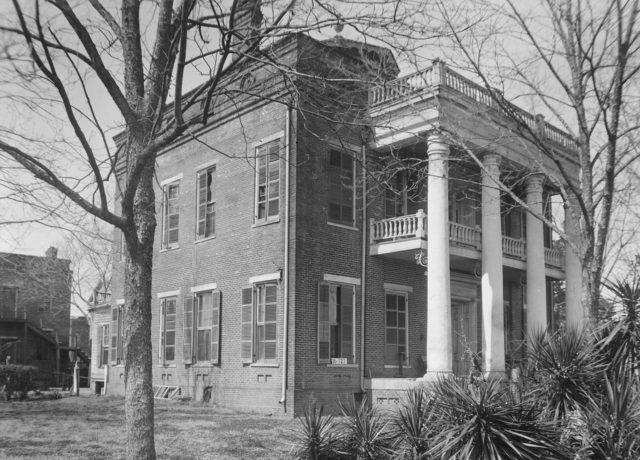 Kirkpatrick mansion on Oak Street, burned in 1935. The two-story brick slave quarters remains intact, however.