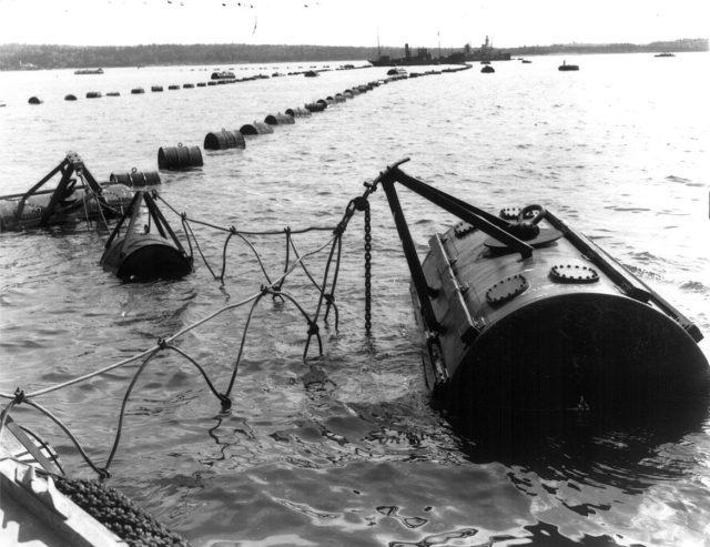 An anti-submarine net running between York Redoubt and McNabs Island; 1 May 1942.