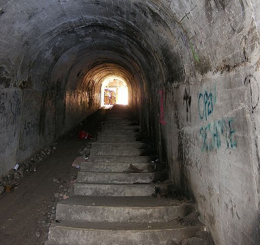 Tunnel inside Illowra Battery with tracks for carts to haul munitions to the gun emplacements. AuthorAdam.J.W.C.CC BY 3.0