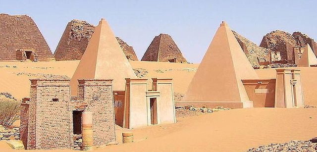 Wide view of Nubian pyramids at Meroë. Three of the pyramids are reconstructed.