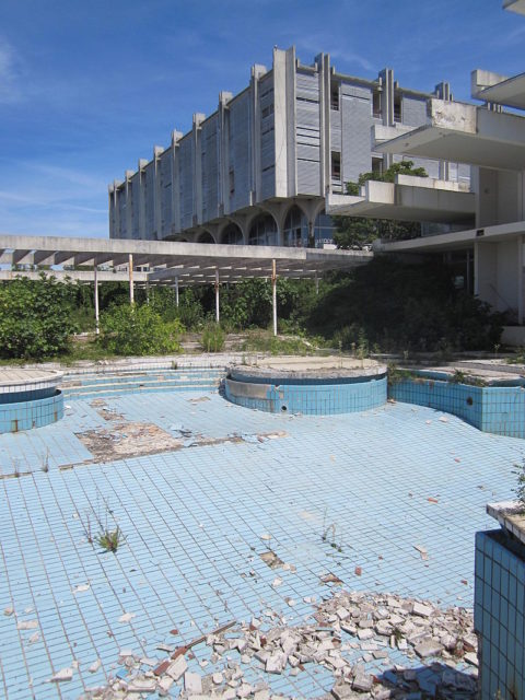 The ruin of Haludovo Palace Hotel as seen from the pool area. Author:Thorsten Schroeteler