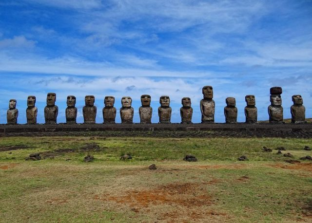 All fifteen standing moai at Ahu Tongariki, excavated and restored in the 1990s. Photo Credit