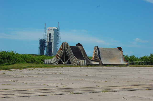 Abandoned Saturn I and IB flame deflectors. Pad 37 is in the background. – Author: Bubba73 – CC BY-SA 3.0