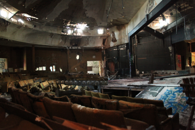 The abandoned community theater is one of the few buildings that remain on the peninsula (shown here as it stands August 2012.). Author: Lastchance1291. CC BY-SA 3.0