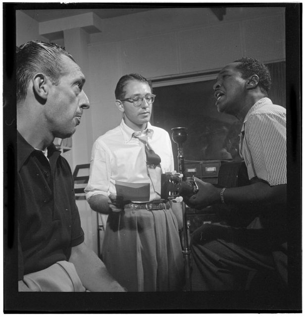 Symphony Sid (left) with Josh White (right), WHOM, New York, in the 1940s. Sid was a regular DJ at the Village Gate. Author: William P. Gottlieb. Public Domain
