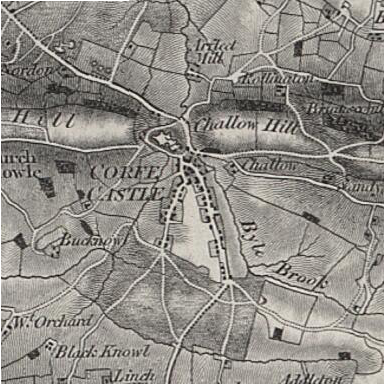 Ordnance Survey map of Corfe Castle in 1856, showing the castle and village in the gap of the Purbeck Hills