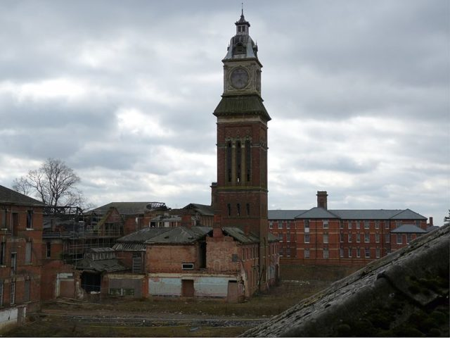 The Asylum and the water tower in 2010.Author:Sandyjune96 Public Domain