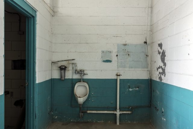 Urinal and crude pipe fixtures.