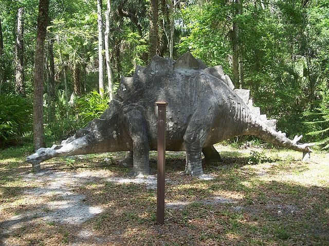 A statue of a concrete stegosaurus from the time when the place was theme park known as Bongoland. Author:Ebyabe – CC BY 2.5