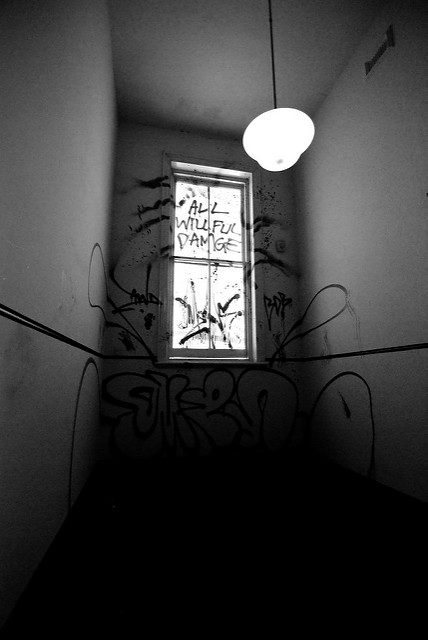 A graffiti-covered window. Author: Nate Robert CC BY 2.0