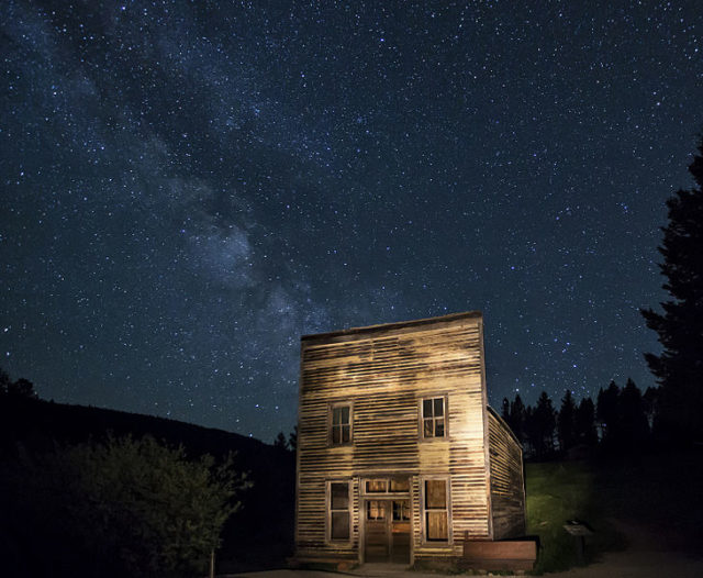 Night photograph of an abandoned building. Author: Bureau of Land Management – Garnet Ghost Town, Montana Public Domain.