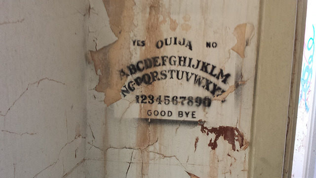 Ouija game board graffiti. Author: Bailey Hurlow CC BY-SA 2.0