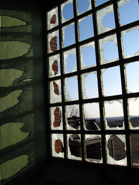 Sun rays through a broken window. Author: Christina Welsh CC BY-ND 2.0