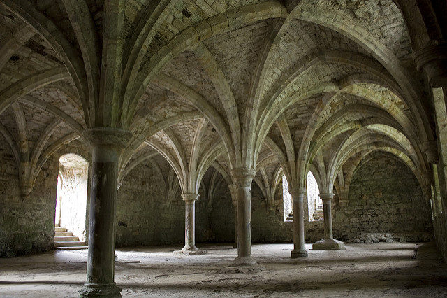 The abbey was designed in the French Romanesque architectural style. Author: Rick Rowland. CC BY 2.0