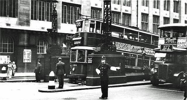Kingsway Tram Tunnel in September 1933, just a few months after the London Passenger Transport Board took over the Central London tram system from the LCC. The No 35 tram is emerging from the northbound tunnel on its way to Highgate having started its journey in Forest Hill, South London. The Police Constable controlling traffic is probably from 'E' Division, either Holborn or Bow Street.