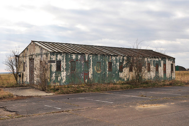 Decaying boarded up barrack. Author:agweightmanCC BY-ND 2.0