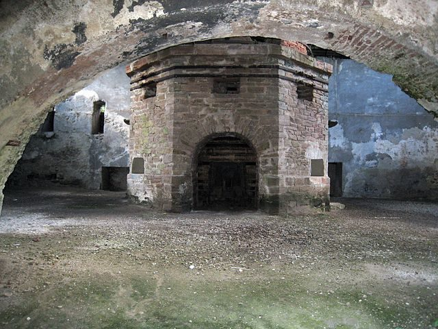 """Govăjdia blast furnace, view of the """"bosh"""", blastholes, and the crucible with the taphole of the blast furnace – Author: Rudolf Hanzelik – CC BY 2.5"""