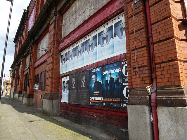 Its red brick facade used for movie posters. Author:MikeyCC BY 2.0